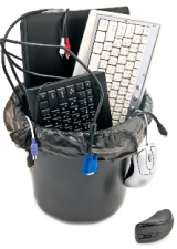 Recycle Waste Basket With Keyboards, Cords, and a Laptop Inside